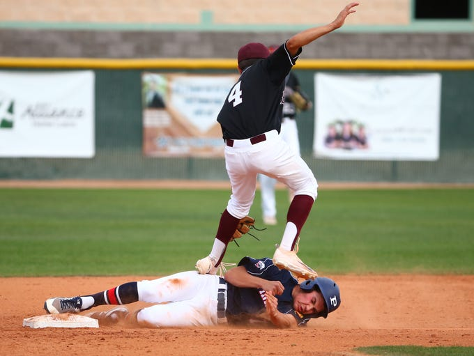 Pinnacle High's Griffin Hamel (7) slides safely into