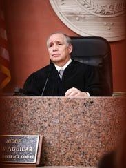 District Judge Luis Aguilar, presiding judge in the