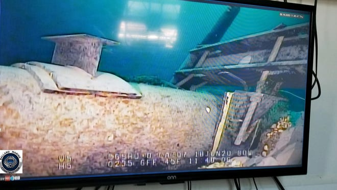 This June 2020 photo, shot from a television screen provided by the Michigan Department of Environment, Great Lakes, and Energy shows damage to anchor support EP-17-1 on the east leg of the Enbridge Line 5 pipeline within the Straits of Mackinac in Michigan. Enbridge who provided the photos to the state of Michigan, last week said an anchor support on the east leg of the pipeline, right, had shifted.  A Michigan regulatory panel refused Tuesday, June 30, 2020, to grant quick permission to run a new oil pipeline beneath a channel that connects two of the Great Lakes, deciding instead to conduct a full review. Enbridge filed an application in April with the Michigan Public Service Commission to relocate a segment of its Line 5 that extends beneath the Straits of Mackinac, which links Lakes Huron and Michigan.