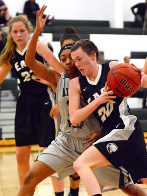 South Lyon East's Peyton Jones (with ball) looks for an opening against the Arbor Prep defense.
