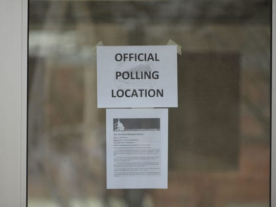A sign on the door of Orchard School in South Burlington identifies the school as a city polling station on Town Meeting Day, March 7, 2017.