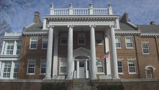 The front of the University of Iowa President's Residence, 102 Church St., is seen in 2005. With the university between its 20th and 21st presidents, UI officials have begun addressing about $1.5 million in deferred maintenance. By the end of the fall semester, work at the residence is expected to reach the point where it will be usable for several months. Work should be completed before the end of spring semester.