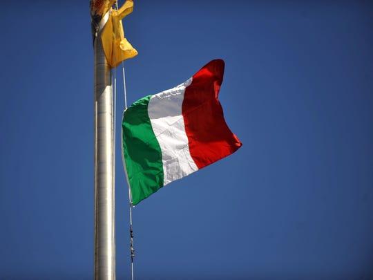 An Italian flag flies over Vineland City Hall Monday, Oct. 10, 2016.
