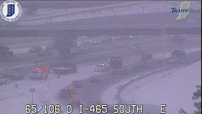 Fresh snowfall hinders traffic on Interstate 465 South.