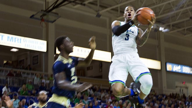 Florida Gulf Coast University sophomore, Rayjon Tucker, goes up for a shot during the game against Florida International University on Sunday, December 11, 2016 at Alico Arena in Estero, Fla.