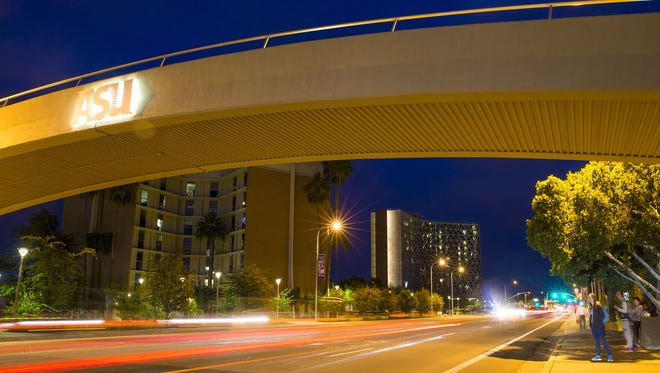 Traffic flows on University Drive in front of Palo Verde East, left, and Manzanita Hall, right, at Arizona State University's Tempe campus.