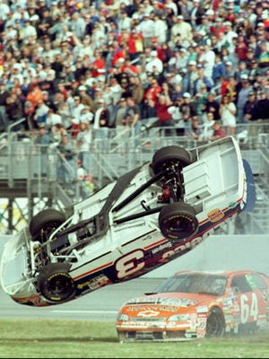 Dale Earnhardt Jr. flips on the back stretch at Daytona International Speedway in NAPA Auto Parts 300 on Feb. 14, 1998, after Dick Trickle (right) was bumped into him.