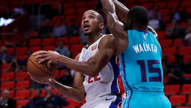 Pistons guard Avery Bradley is defended by Charlotte Hornets guard Kemba Walker in the second half of an NBA preseason game Wednesday, Oct. 4, 2017 in Detroit.