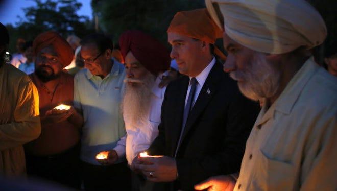 Wisconsin Gov. Scott Walker at a Sikh temple in Brookfield in 2012.