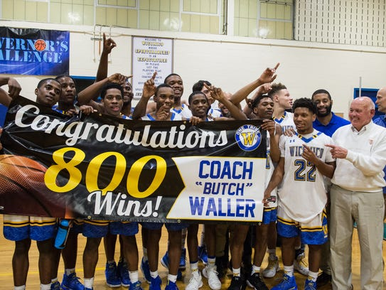 Members of the Wi-Hi boy's basketball team celebrate