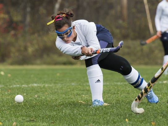 MMU's Margaret Thompson (9) hits the ball down the