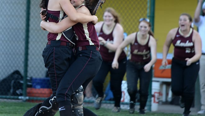 Pittsford Mendon pitcher Taryn Welch, right, hugs catcher Anna Merante after the final out of the Section V Class A1 Championship played at SUNY Brockport on Thursday.