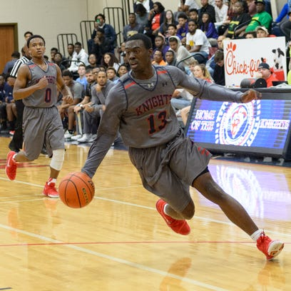 Greg Williams Jr drives to the basket as LCA takes