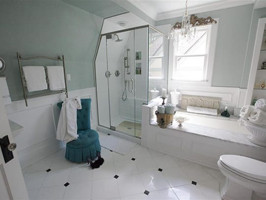 Homeowner Claire Bockwith turned her tiny and tired 1936 bathroom into an opulent â??jewel boxâ? spa with Paphos and Carrara marble, a chandelier and white  porcelain accessories.