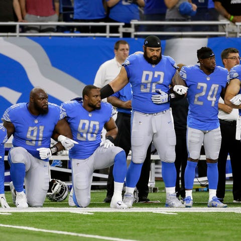 Sept. 24, 2017: Lions players link arms and kneel...
