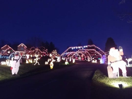 "Four homes encompass the ""Santa Claus Lane"" display in the 6700 block of Taylor Road in Green Township."