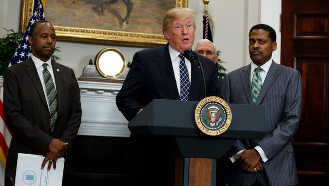 President Donald Trump speaks during an event to honor Dr. Martin Luther King Jr., in the Roosevelt Room of the White House, Friday, Jan. 12, 2018, in Washington. From left, Secretary of Housing and Urban Development Ben Carson, Trump, Vice President Mike Pence, and Isaac Newton Farris Jr., nephew of Martin Luther King Jr.