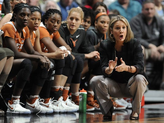 FILE - In this Sunday, Dec. 4, 2016, Texas head coach Karen Aston, right, urges on her players in the first half of an NCAA college basketball game in Uncasville, Conn. Texas (2-4) will remain below .500 whether it wins or loses Sunday's matchup against Tennessee in Austin, Texas(AP Photo/Jessica Hill, File)