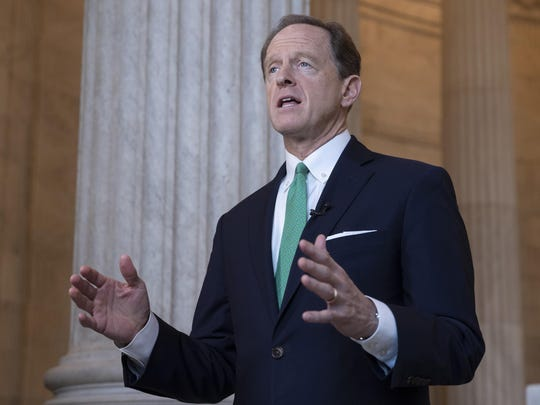 FILE - In this Oct. 2, 2018, file photo, Sen. Pat Toomey, R-Pa., speaks during a television news interview on Capitol Hill in Washington. For years the federal government for years has kept under wraps the names of hundreds of nursing homes around the country found to have serious health, safety or sanitary problems. Lawmakers say the silence calls into question the government's commitment to families going through the difficult process of finding a nursing home for a loved one. The secrecy began to crack June 3, 2019, when two U.S. senators from Pennsylvania released the government's list.. (AP Photo/J. Scott Applewhite, file)