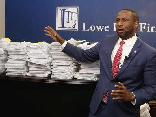 Oklahoma state Rep. Jason Lowe, D-Oklahoma City, gestures to a stack of petitions during a news conference, in Oklahoma City. A group led by Lowe and the gun safety group Moms Demand Action, seeking to stop a new law that would allow people in Oklahoma to openly carry firearms without training or a background check, is acknowledging they fell short of the number of signatures needed for a statewide vote on the issue.