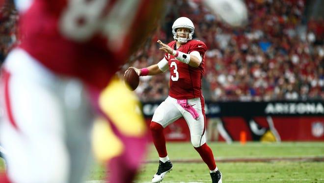Cardinals quarterback Carson Palmer runs out of the pocket against Washington Redskins on Oct. 12, 2014 at University of Phoenix Stadium in Glendale.