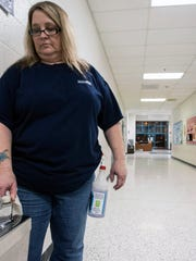 Brandeis Elementary custodian Tammy Beisler sanitizes water fountains, and then runs the water for thirty seconds each morning to clear the aging pipes of any overnight built up. March 10, 2016