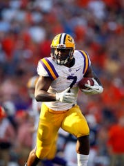 Sep 24, 2016; Auburn, AL, USA;  LSU Tigers running back Leonard Fournette (7) carries against the Auburn Tigers during the first quarter at Jordan Hare Stadium. Mandatory Credit: John Reed-USA TODAY Sports