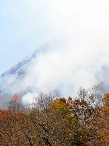 Smoke billows up out of the mountains from the Party