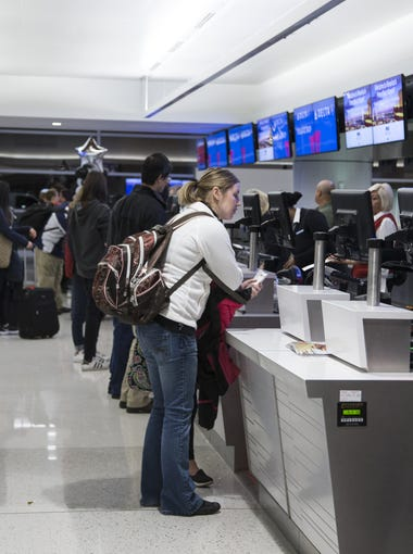 Passengers' check-in at the Delta ticket counters at Phoenix Sky Harbor International Airport's Terminal 3, December 6, 2016 in Phoenix.