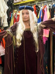 Karen Dean tries out a Renaissance Era costume at The Nitty Gritty that can be tweaked as a possible Game of Thrones costume for Halloween. 10/17/17