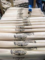 Stacks of bats at the Louisville Slugger Factory were