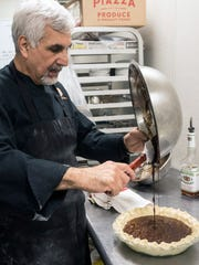 The melted chocolate is added last after the other ingredients in Anoosh Shariat's pecan pie recipe have been properly mixed. 11/7/17