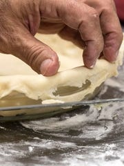 Anoosh Shariat trims the crust around the edges of the baking dish but notes that it need not be perfect given its homemade charm. 11/7/17