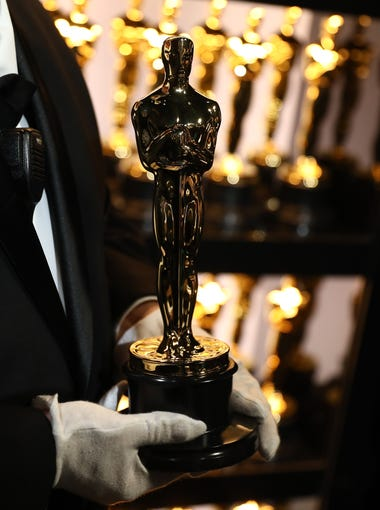 Go backstage at the 90th annual Academy Awards with USA TODAY. Here, a staffer holds an Oscar trophy in gloved hands before it's taken to the stage for presentation. Later in the evening, its new owner will get their name and film engraved on it. Click forward to see more candid photos from backstage.