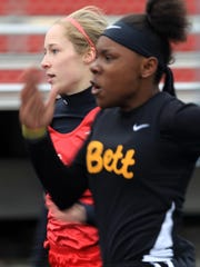 City High's Sarah Plock competes in the 100 meter dash