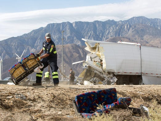 Workers remove pieces of wreckage on Interstate 10.