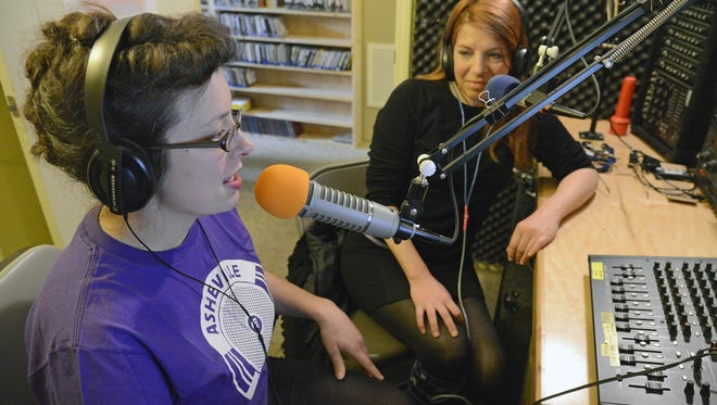 Kim Roney, left, station co-manager, and Michele Scheve, publicity co-director, in the broadcast studios of Asheville Free Media, an online community radio station at www.ashevillefm.org. The station recently recieved its license to broadcast over the radio.