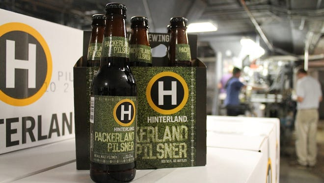 The first batch of Packerland Pilsner was bottled and kegged Thursday at Hinterland Brewing.