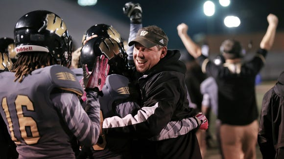 Warren Central players and coaches start their celebration on the sidelines with seconds left on the clock during their 12-7 win over Center Grove on Friday, November 15, 2013 at Warren Central High School. Matt Detrich / The Star