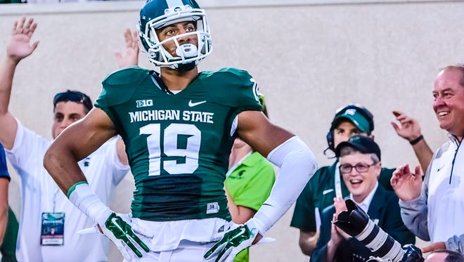 MSU's AJ Troup celebrates after scoring a touchdown late in the 1st quarter of the Spartans' game with Jacksonville State.