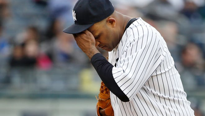 CC Sabathia reacts on the mound after allowing an inside-the-park home run to Tampa Bay's Wil Myers on Sunday.