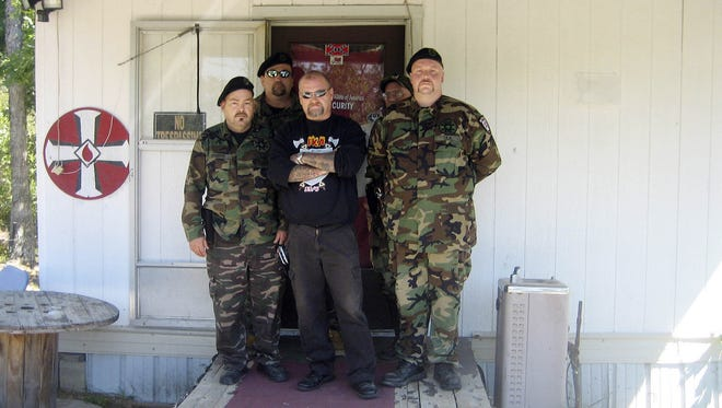 Ronald Edwards, center, stands on Sept. 13, 2007, with guards at the Imperial Klans of America's 28-acre compound near Dawson Springs, Ky.