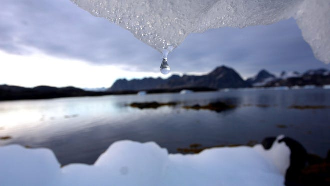 In this Aug, 16, 2005, file photo an iceberg melts in Kulusuk, Greenland, near the arctic circle.