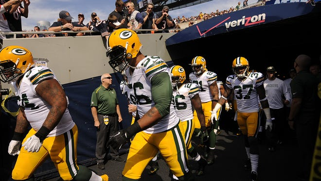 Julius Peppers and the Green Bay Packers players take the field before Sunday's game at Soldier Field in Chicago.