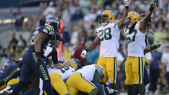 Green Bay Packers Sean Richardson (28) and Jamari Lattimore (57) point to their goal line on a fumble against the Seattle Seahawks at CenturyLink Field in Seattle, Wash., on Thursday, Sept. 4, 2014. Evan Siegle/Press-Gazette Media