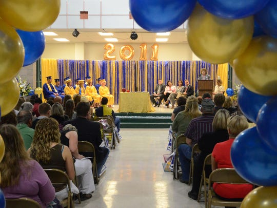 6/7/2011 Gerlach graduates sit on stage during graduation Tuesday in Gerlach.  This graduation will be the high schools last because of the closing of the Empire Mine near Gerlach.