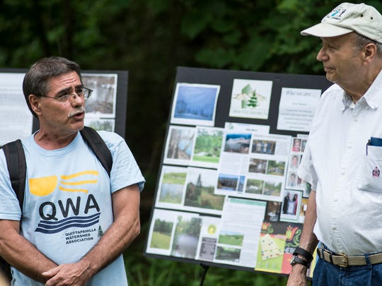 Michael Schroder, left, president of the Quittapahilla Watershed Association, and  David Lasky, board member of the Lebanon Valley Conservancy, talk about Phase 2 of the Quittapahilla Stream Bank Restoration project at Quittie Creek Nature Park in Annville on Thursday, June 23, 2016.