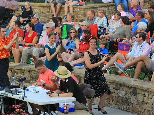 Swing dancers perform during the opening of The City of Anderson & 24 Hour Musical, Inc.'s production of Much Ado About Nothing, a William Skakespeare, at Carolina Wren Park in downtown Anderson last year.
