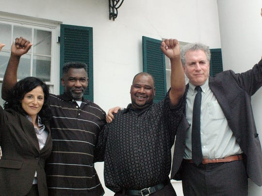 Levon Brooks, second from left, and Kennedy Brewer, second from right, celebrate outside the Noxubee County Courthouse in Macon in 2008 with their lawyers from New-York-based Innocence Project. Far left is Vanessa Potkin and far right is Peter Neufeld.