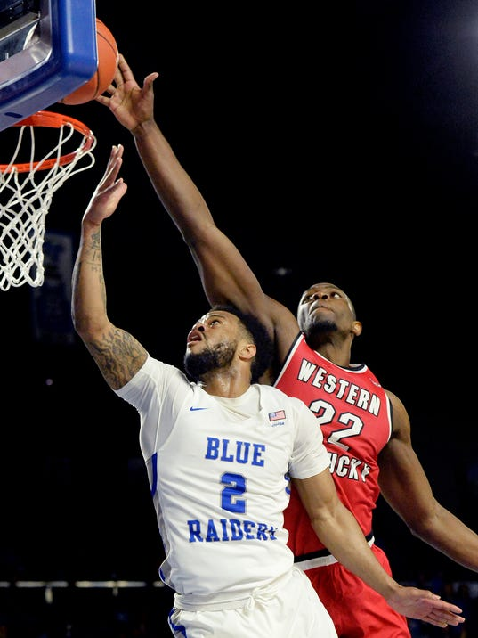 Western Kentucky forward Dwight Coleby (22) blocks a shot by Middle Tennessee guard Antwain Johnson (2) during the first half of an NCAA college basketball game Thursday, March 1, 2018, in Murfreesboro, Tenn. (AP Photo/Mark Zaleski)